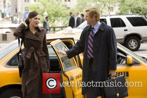 Maggie Gyllenhaal and Aaron Eckhart 1