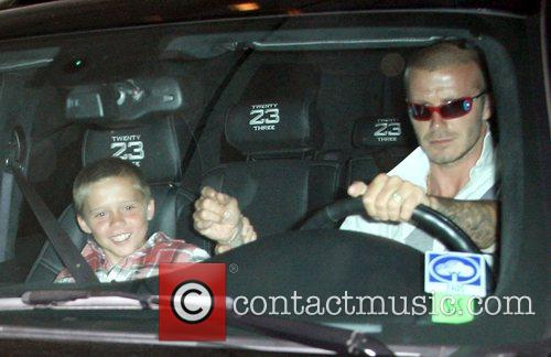 Brooklyn Beckham and his father David Beckham leaving...