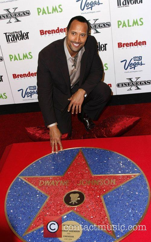 Is presented with a celebrity star by Johnny...