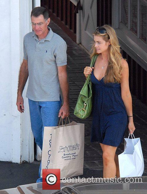 Denise Richards goes shopping with her father in...