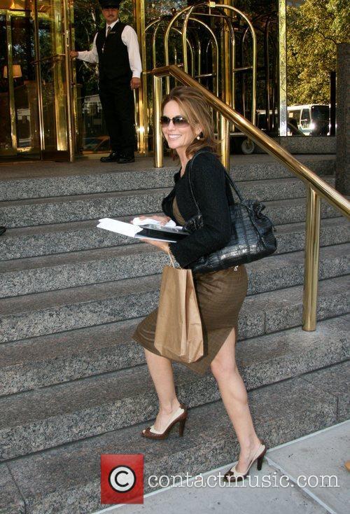 Arrives at her hotel