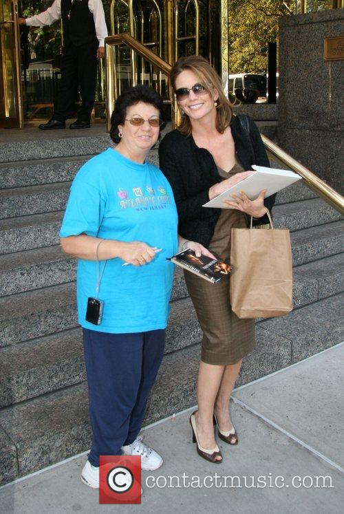 Diane Lane poses with autograph seeker Linda Rosda...