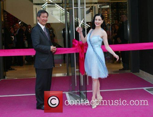 Cuts the ribbon at the opening celebrations for...