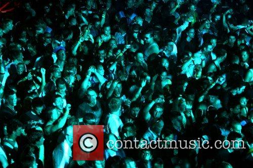 Crowd of fans DJ Tiesto performing live at...