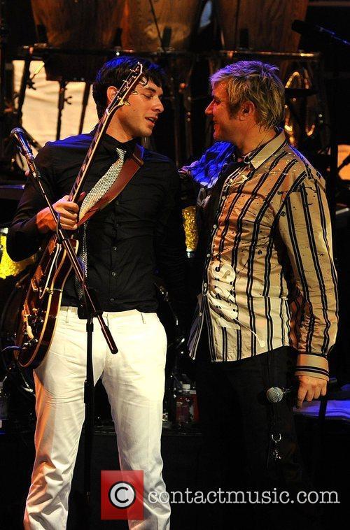 Simon Le Bon and Mark Ronson performing at...