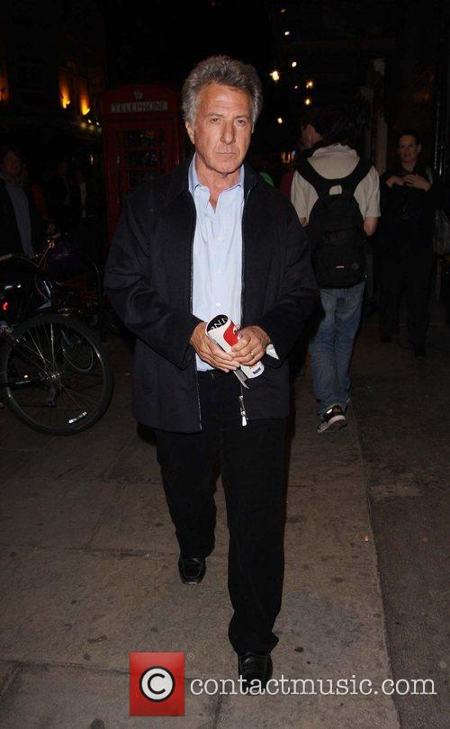 Dustin Hoffman walking in Soho after watching a...