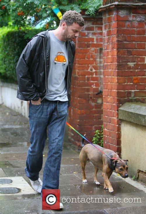 Taking his ex-girlfriend Lily Allen's new dog for...