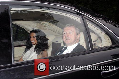 Louis Walsh and Guest arriving at a party...