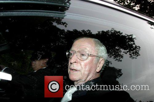 Sir Michael Caine arriving at a party hosted...