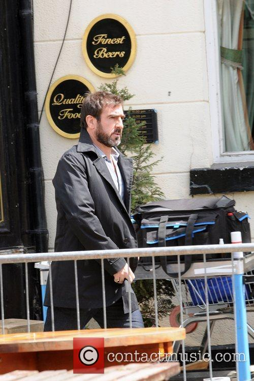 Eric Cantona filming on the movie set of...