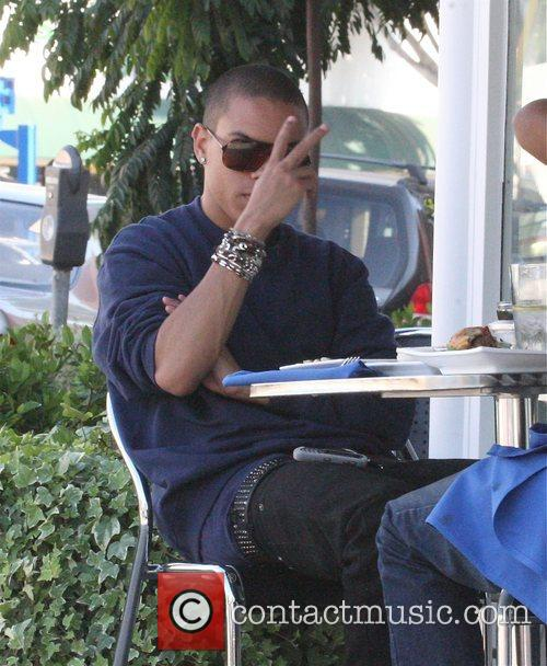 Has lunch with a friend in West Hollywood