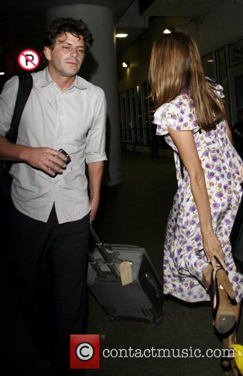 Arrives at Lax Airport with her boyfriend George...