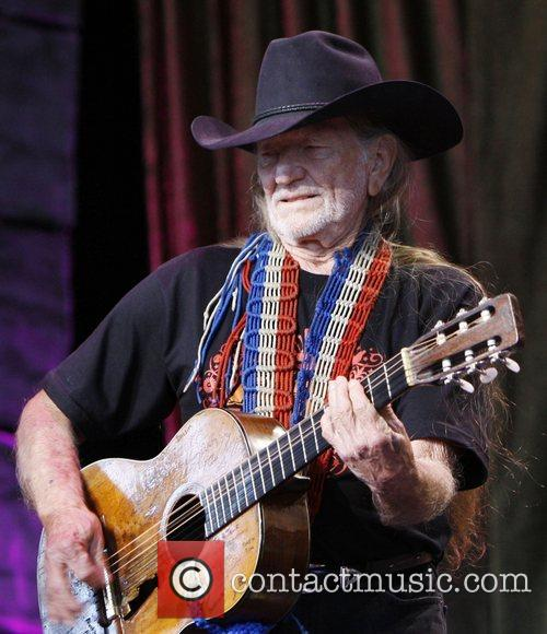 Willie Nelson performs during Farm Aid 2008 at...