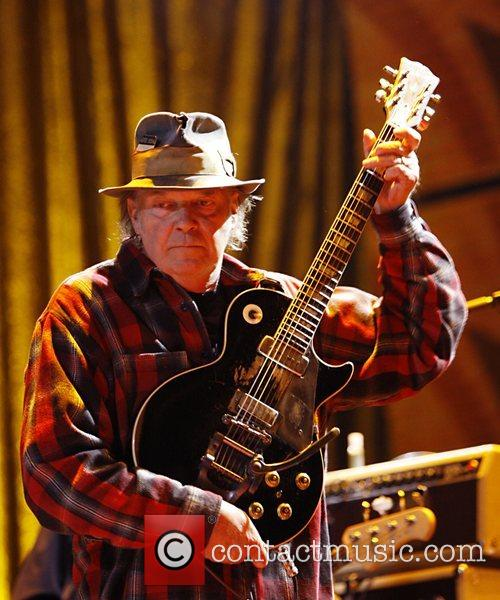 Neil Young  performs during Farm Aid 2008...