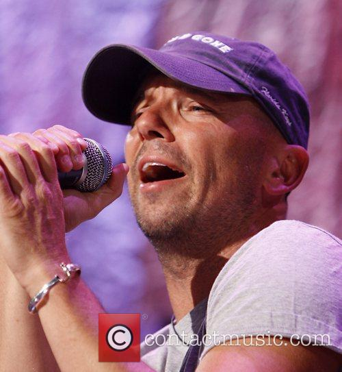 Kenny Chesney performs during Farm Aid 2008 at...