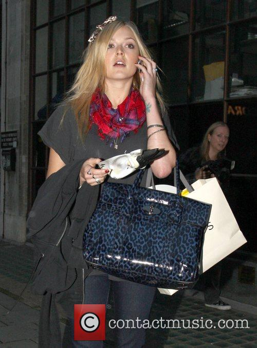 Fearne Cotton talking on the phone while leaving...