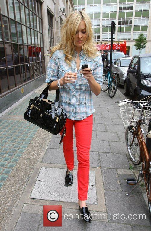 Fearne Cotton leaving Radio 1 studios with untidy...