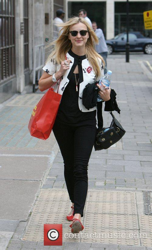Fearne Cotton leaves the Radio 1 studios carrying...