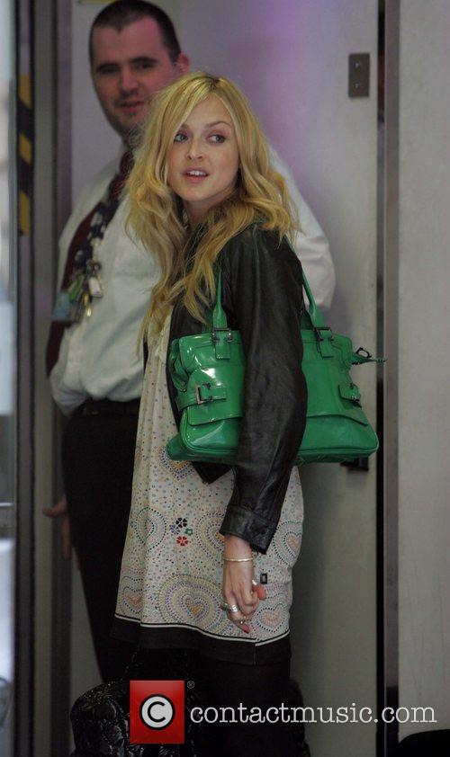Seen leaving Radio 1 with her new boyfriend...