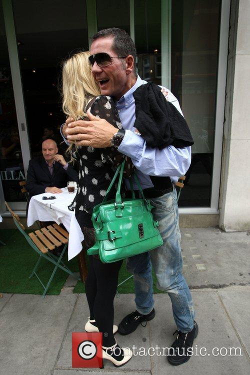 Fearne Cotton and Dale Winton greet one another...