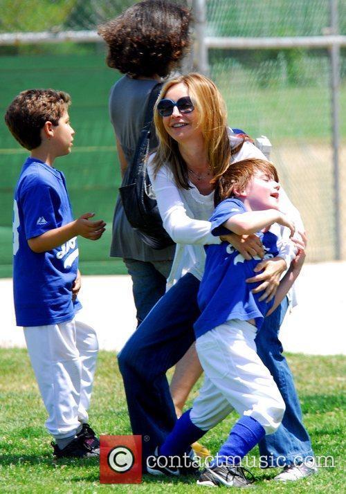Calista Flockhart watching her son Liam play baseball