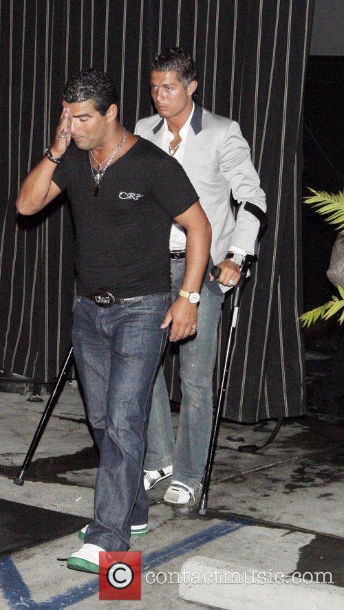 Cristiano Ronaldo leaving Foxtail on crutches