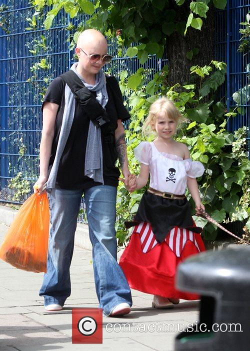 Walking with her daughter Honey, who is dressed...