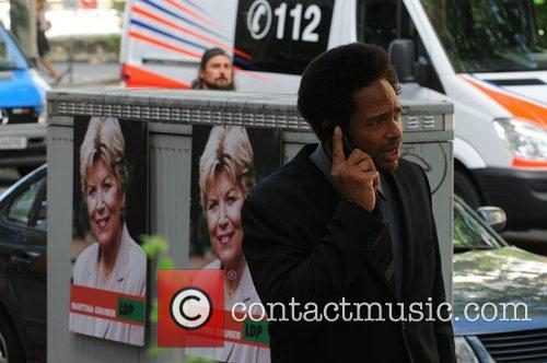 Gary Dourdan uses a mobile phone at the...