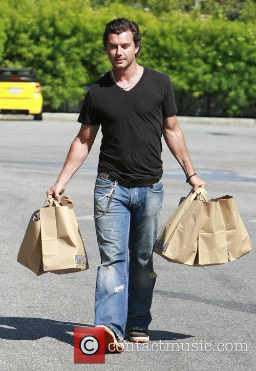 Is laden with bags as he shops for...