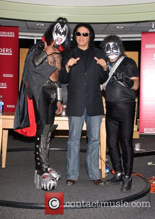 Gene Simmons with two Kiss fans Gene Simmons...