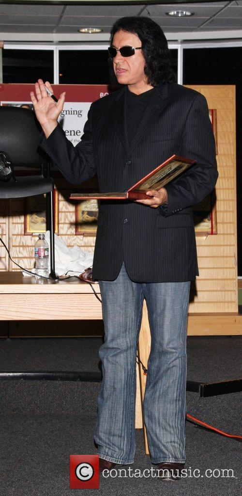 Gene Simmons  signs copies of his new...