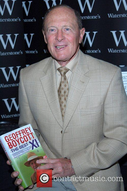 Geoffrey Boycott signs copies of his new book...