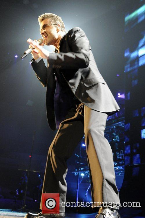 George Michael kicking off his US tour performing...