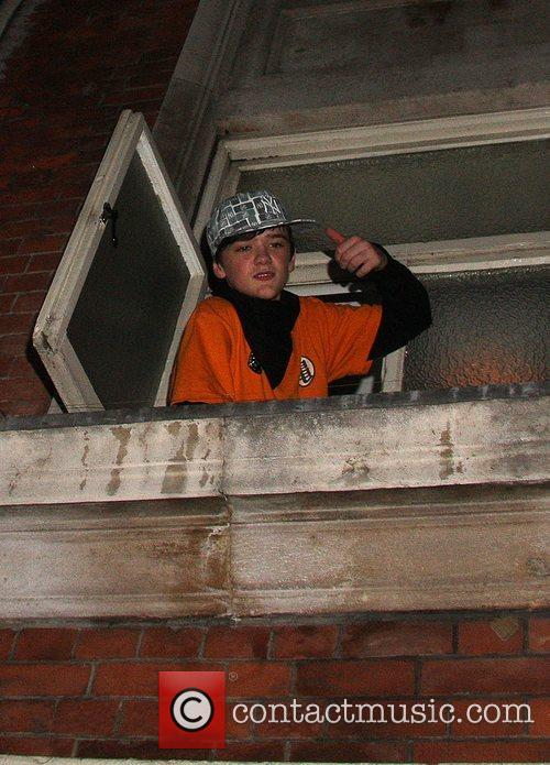 George Sampson hangs out of a third floor...