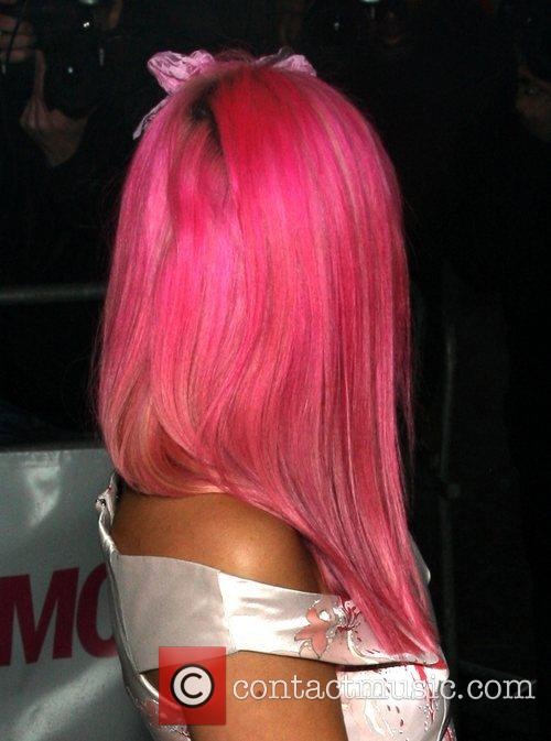 Lily Allen with pink hair and black roots...
