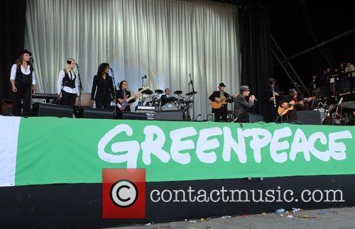 Leonard Cohen performing at The Glastonbury Music Festival,...