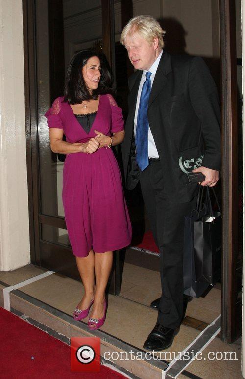 Boris Johnson holding his award for Politician of...
