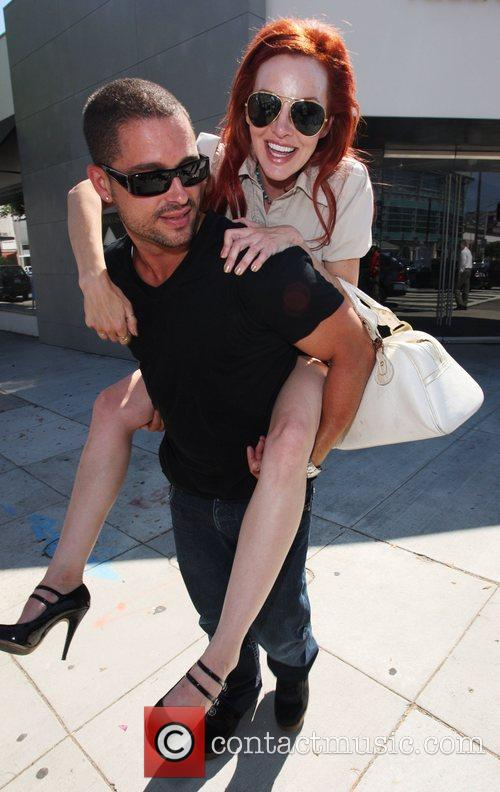 Leaves the Ivy restaurant on Robertson Blvd with...