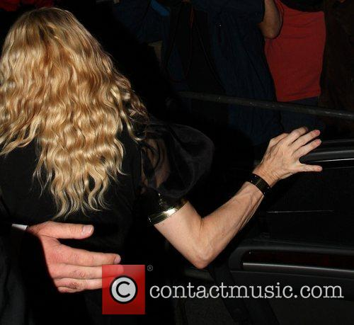 Madonna is in high spirits as she arrives...