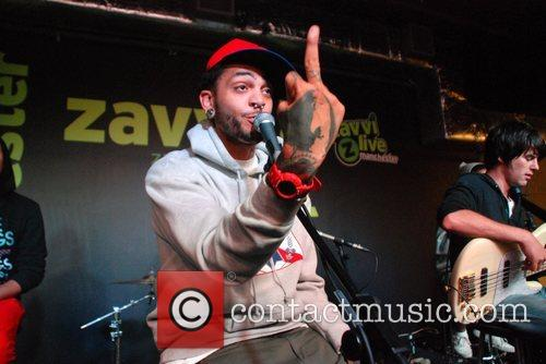 Travis McCoy Gym Class Heroes performing a live...