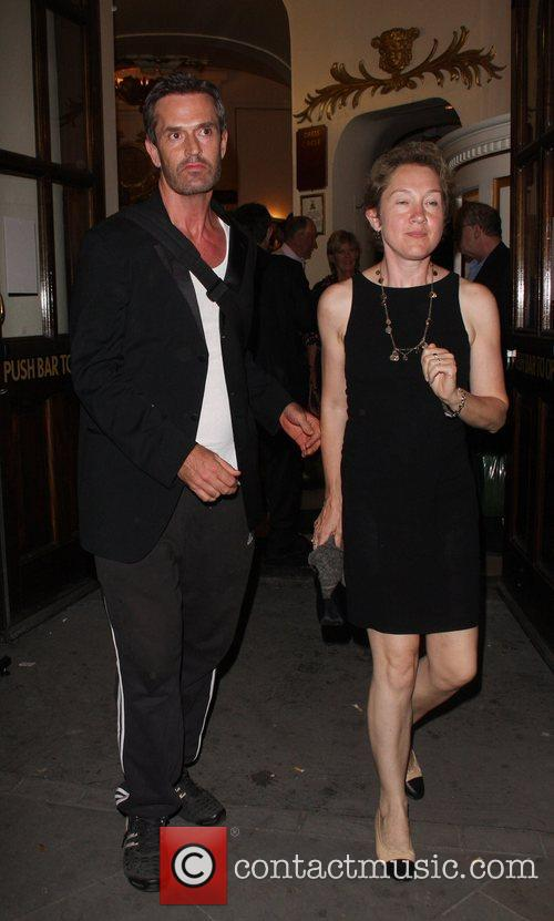 Rupert Everett and guest leaving the press night...