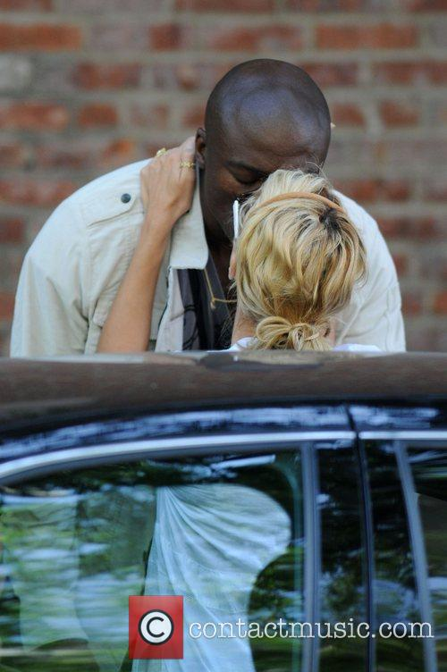 Heidi Klum and Seal share a kiss as...