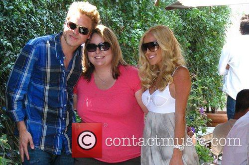 Heidi Montag and Spencer Pratt with a fan...