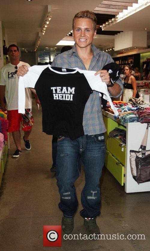 Spencer Pratt holds up a t-shirt from his...