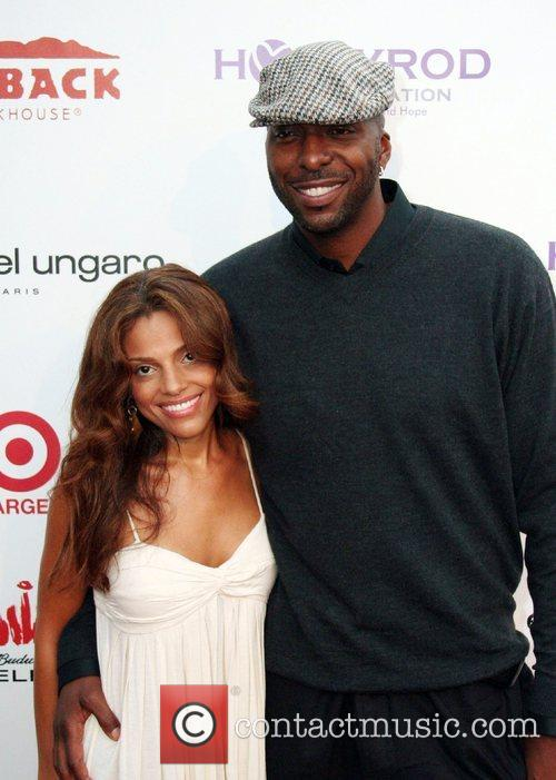 Natasha Salley and John Salley