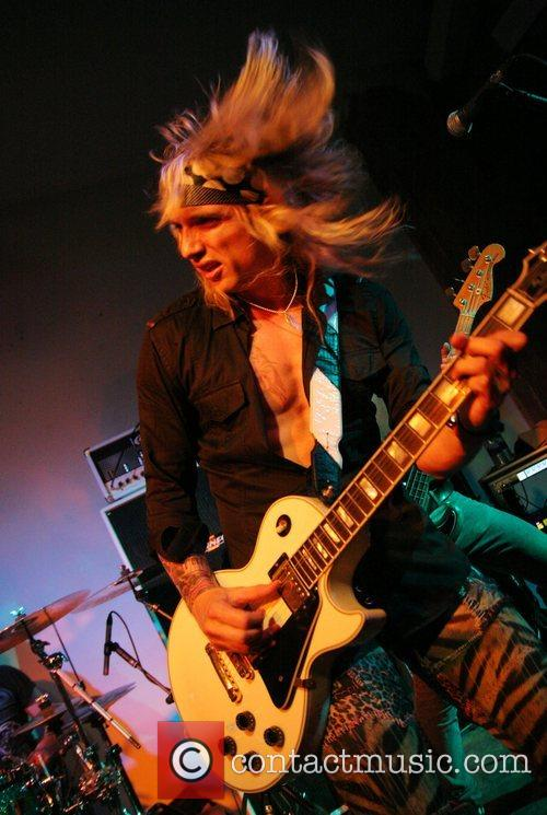 Performs with his new band Hot Legs at...