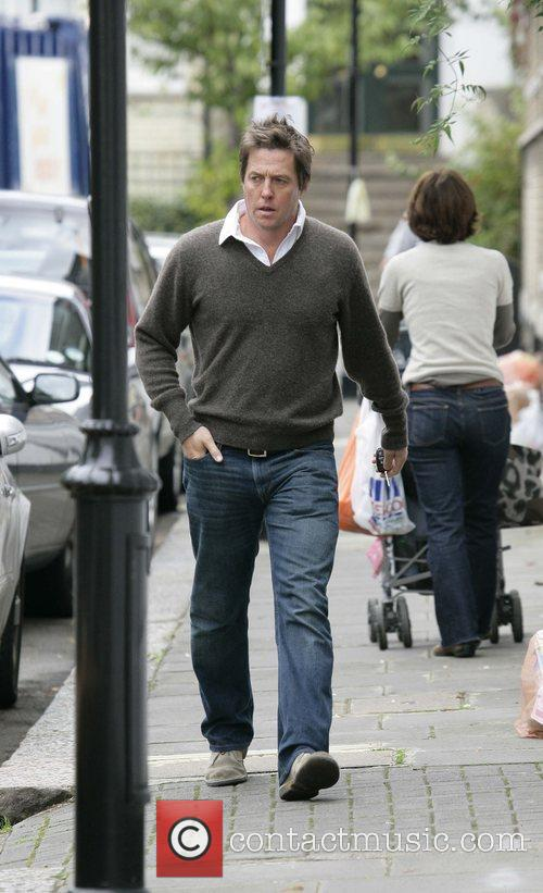 Hugh Grant on his 48th birthday walking from...