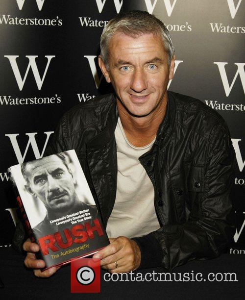 Signs copies of his book 'Rush: The Autobiography'...