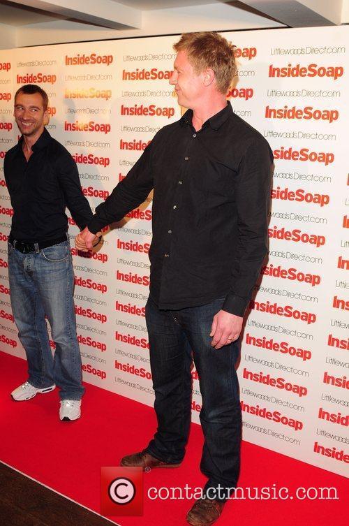 Matthew Crompton and Charlie Condu hold hands...