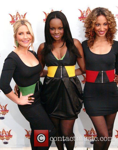 Heidi Range, Keisha Buchanan and Amelie Berrebah backstage...